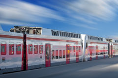 White train. White modern train driving fast Royalty Free Stock Images