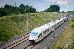 White train passes over the bridge. Eupen,Belgium - August 20, 2015: Thalys high-speed train passes over the bridge between Liege and Aachen Stock Photos