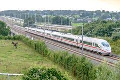 White train passes over the bridge. Eupen,Belgium - August 20, 2015: Thalys high-speed train passes over the bridge between Liege and Aachen Stock Photo