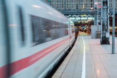 Train moving away from station royalty free stock images
