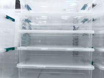 White transparent Plastic food containers on the shelf in the store stock photography