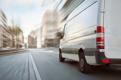 White transporter driving inside the city royalty free stock images