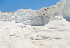 White travertine and flowing water against blue sky Royalty Free Stock Photos