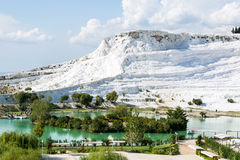 White travertine hill and lake Royalty Free Stock Photos