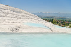 White travertine terrace cascade with turquoise blue lakes Royalty Free Stock Photo