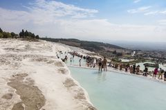 Mineral rich waters of natural pools in Pamukkale, Turkey. White travertine terraces of Pamukkale or Cotton Palace with the mineral-rich thermal waters in the royalty free stock photos