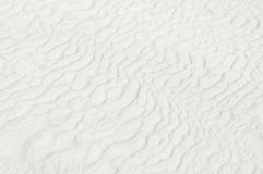 White travertine with wavy shaped lines background Stock Photography