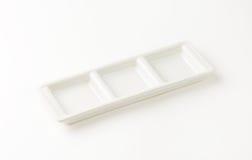 White tray. Empty white tray on white background royalty free stock photo