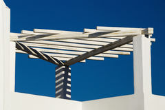 White Trellis With Shadows Against Blue Sky Royalty Free Stock Photos