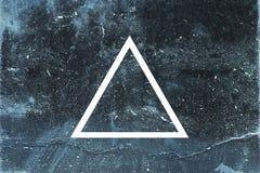 White triangle on dark background. White flat triangle on abstract stone background. Abstract psychedelic background Stock Images