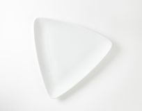 White triangular plate Stock Images
