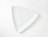 White triangular plate Stock Images