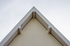 White triangular roof side of temple stock photography