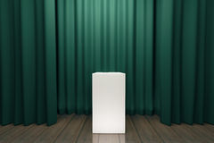 White tribune in the center of empty stage with green scenes Royalty Free Stock Photography