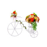 White tricycle decorate with fabric flowers on white background. White tricycle decorate with colorful fabric flowers and plastic grape on the white basket stock photo