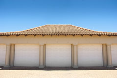 White triple garage doors Stock Image