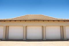 White triple garage doors stock image