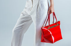 White trousers and red bag Stock Image