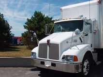 White Truck. A white truck stands in the sunshine at a freeway rest area in North America stock photos