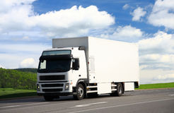 White truck. Driving on a road Royalty Free Stock Photos