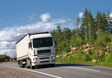 White truck on country highway. White truck on summer highway Scandinavia Stock Photography