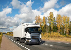 White truck on country highway under blue sky Royalty Free Stock Images