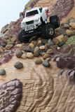 White truck drive through rocks Stock Image