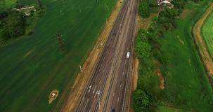 White truck driving on the highway. The road to the city. Shot with DJI Phantom 4 stock video