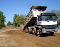 White truck dumper. Truck dumper on construction site Royalty Free Stock Image