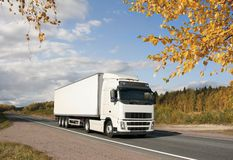 White truck on golden highway. White truck on golden autumn highway , landscape Royalty Free Stock Photography