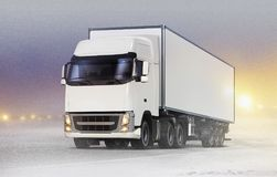 White truck on ice road in blizzard. White truck with cargo container on ice road in blizzard royalty free illustration