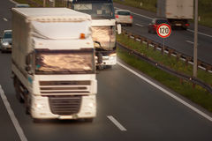 White truck in motion blur and bus on highway Stock Photography
