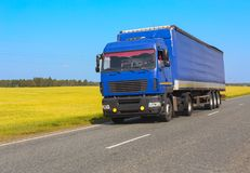 White truck moves on highway. Big white truck moves on highway Stock Images