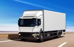 White truck moving on freeway stock photography