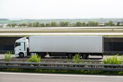 White truck moving on a highway Royalty Free Stock Photo