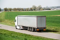 White truck moving on a main road Royalty Free Stock Photography