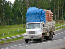 White truck overloaded with sewage pipes Royalty Free Stock Photos