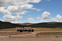 White truck at Qinghai-Tibet Highway Royalty Free Stock Image