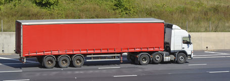 White truck with red articulated trailer Royalty Free Stock Photography