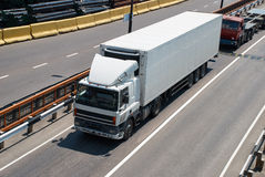 White truck on road. Cargo transportation Royalty Free Stock Image