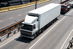 White truck on road. Cargo transportation Stock Image