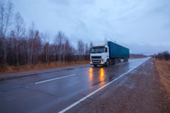 White truck on a road in early morning stock images