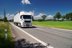 White truck on the road in a rural landscape Royalty Free Stock Images