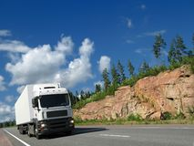 White truck on rocky highway Royalty Free Stock Photo