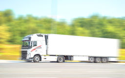 White Truck. Speed on Highway Stock Images