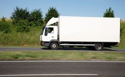 White truck speeding on freeway Royalty Free Stock Images