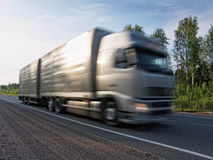 White truck speeding on rural highway, motion blur Royalty Free Stock Image