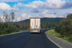 White truck transports freight Royalty Free Stock Images