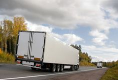 White trucks on highway. Truck caravan  on highway Scandinavia, rear view Royalty Free Stock Photography