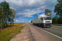 White trucks traveling on the highway Stock Photos